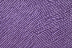 Purple background from soft textile material. Fabric with natural texture. Stock Photography