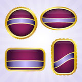 Purple badges with ribbon Stock Photos
