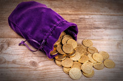 Purple Bag With Coins Royalty Free Stock Image
