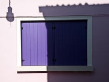 Purple balcony on pink wall. In Venice Royalty Free Stock Photos