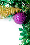 Purple ball and golden Christmas tree. Christmas and New Year decoration - purple ball and golden Christmas tree on a green background Royalty Free Stock Photos