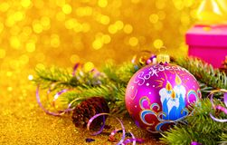 Purple ball with the words Merry Christmas on a gold background with bokeh. Purple ball with the words Merry Christmas on a gold background stock photos