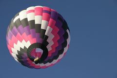 Purple balloon 1. Colorful hot air balloon in clear sky with plenty of room for text Stock Photos