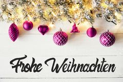 Purple Balls, Calligraphy Frohe Weihnachten Means Merry Christmas. Christmas Banner With German Calligraphy Frohe Weihnachten Means Merry Christmas. Fir tree royalty free stock images
