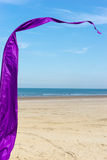 A purple banner. On a sunny beach Stock Photo