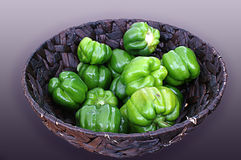 Purple Basket of Green Bell Peppers Royalty Free Stock Images