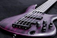 Purple bass guitar (shallow depth of field) Royalty Free Stock Photos