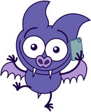 Purple bat talking on a smartphone Stock Photos