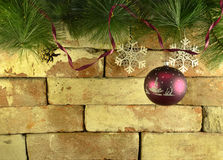 Purple bauble on brick wall Stock Photography