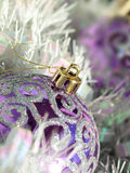 Purple Bauble and Tinsel Stock Photo