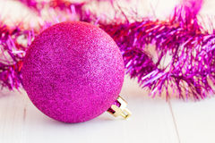Purple bauble and tinsel Stock Photos