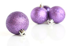 Purple baubles Stock Image