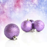 Purple baubles Stock Images