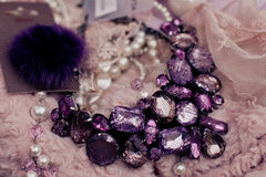 Purple beads on fur and lace background Stock Image