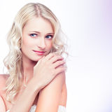 Purple beauty. Portrait of a sensual young blond woman on white background Royalty Free Stock Image