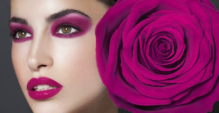 Purple beauty makeup. Beautiful model with purple makeup, close up beauty portrait, rose theme Stock Images