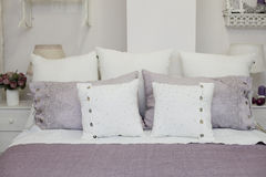 Purple bedclothes Stock Image