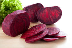 Purple beetroot on wooden board royalty free stock images