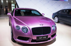 A purple Bentley car. Take on the 16th Chongqing International Motor Show, June 6th-12th, 2014. There are many international famous brand companies and Royalty Free Stock Photography