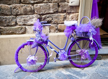 Purple bicycle Stock Images
