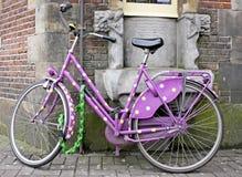 Purple bike. In Amsterdam Holland Royalty Free Stock Image