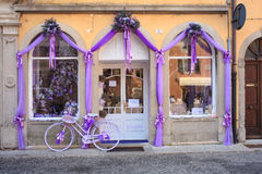 Purple bike next to a lavender shop Stock Photos