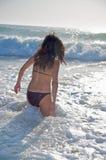 Purple bikini woman ready to swim. Woman at beach of palmar in cadiz spain Stock Photography