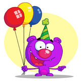 Purple birthday bear Stock Photos