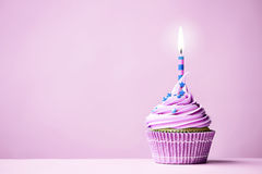 Purple birthday cupcake Royalty Free Stock Image