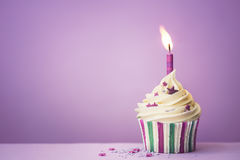 Purple birthday cupcake Stock Photos