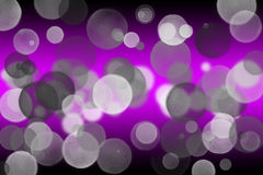 Purple and black background bokeh effect Stock Photos