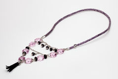 Purple and black necklace Royalty Free Stock Images
