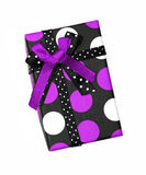 Purple and black ribbon gift bow box. Single purple and black ribbon gift bow box with polka dots isolated on white background Royalty Free Stock Photo