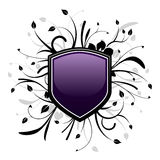 Purple and black shield emblem. With floral design Stock Images