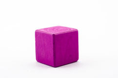 Purple block  isolate. Purple woodden toy block and isolate from white background Royalty Free Stock Photos