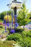 Purple blown glass tubes in Garden Stock Image