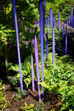 Purple blown glass tubes in Garden Stock Photo