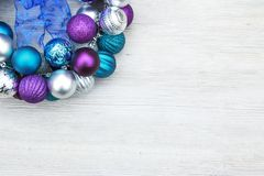 Free Purple, Blue, And Silver Christmas Ball Ornaments On A Wooden Ba Royalty Free Stock Images - 105803909