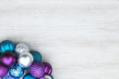 Free Purple, Blue, And Silver Christmas Ball Ornaments On A Wooden Ba Royalty Free Stock Photos - 105804008