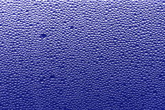 Purple blue background - water drops Stock Photos Royalty Free Stock Images
