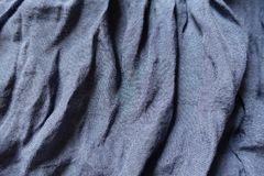 Purple cotton and polyester fabric in soft folds. Purple blue cotton and polyester fabric in soft folds Stock Photos