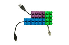 Purple blue green lego connected to usb and phone Royalty Free Stock Images