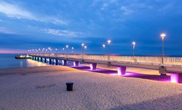 Purple blue lights on the pier in the evening, Kolobrzeg Royalty Free Stock Photo