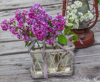 Purple-blue lilac and secateurs on a wooden  table Royalty Free Stock Image