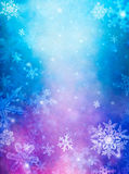 Purple Blue Snow. Snowflakes overlaid with colorful mist and fog.  Images displays a pleasing grain pattern at 100 percent Royalty Free Stock Images