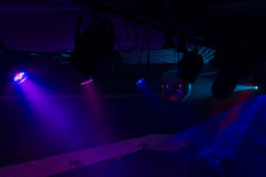 Purple and Blue Spotlights in Night Club Royalty Free Stock Photos
