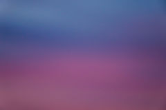 Purple and blue sunset background Stock Images