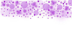 The purple blured balls and snowflakes on a white background Royalty Free Stock Photography