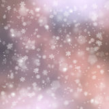 Purple blurry snowflake background Stock Images