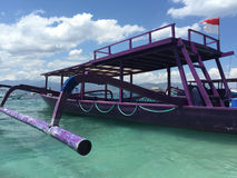 Purple boat. Local boat. a daily used boat for local people to go to another island Stock Photography